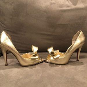 NWOT Paris Hilton gold heels with open toe & bow